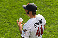 Wearing Joe Mauer sideburns, Drew Butera (41) of the Minnesota Twins warms up before the game against the Tampa Bay Rays on August 10, 2012 at Target Field in Minneapolis, Minnesota.  The Rays defeated the Twins 12 to 6.  Photo: Ben Krause