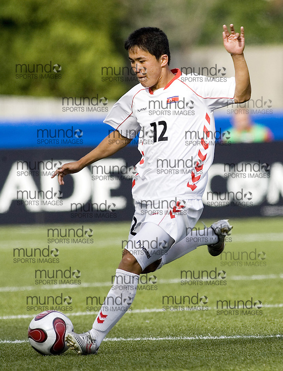 03 July 2007 (Ottawa--Canada) -- The Democratic People's Republic of Korea -- North Korea (PRK) -- ties the Czech Republic (CZE) 2-2 in the group stage of the FIFA U-20 World Cup of Football...Kuk Jin KIM..Photo credit Sean Burges/Mundo Sport Images.