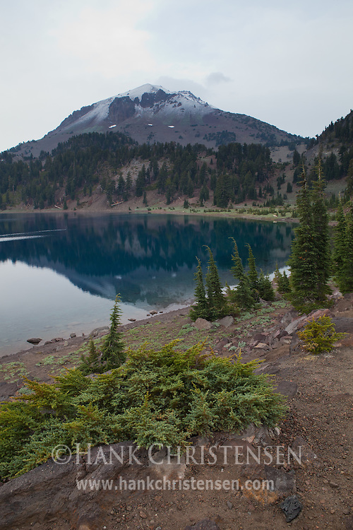 Mt. Lassen is reflected in Lake Helen after a morning snow shower, Lassen National Park, California