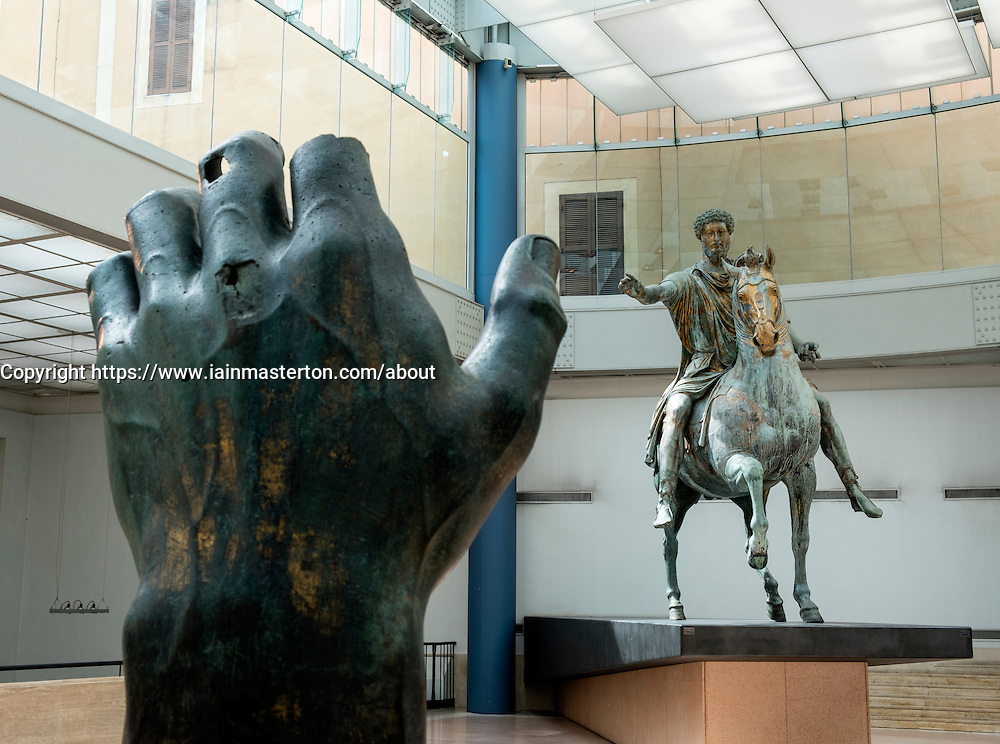 Emperor Marco Aurelio on horseback and hand fragment of the colossal bronze statue of Constantine the Great at  Capitolini Museums Rome Italy.