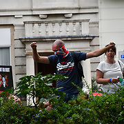"""How saves is London? Stop Tommy, Stop the Racists with all the police presents in the middle two group dislike each other interrupt to entire society and tourism? One side march to """"Free Tommy"""" and another side anti-fascist both side seen quite aggressionson 3 August 2019, Oxford Street, London, UK"""