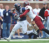 Mississippi running back Jaylen Walton (6) scores on a pass play as Troy safety Rishad Goode (14) defends at Vaught-Hemingway Stadium in Oxford, Miss. on Saturday, November 16, 2013. (AP Photo/Oxford Eagle, Bruce Newman)