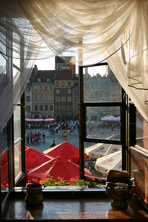 Old Town Square seen through an open second floor restaurant window. Warsaw, Poland.
