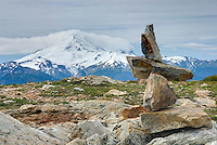 Rock cairn on the slopes of Tomyhoi Mountain Mount Baker Wilderness Washington, Mount Baker (3286 meters 10781 feet) is in the distance