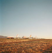 In mid-day heat of the arid Sonoran desert sit the remains of a Boeing airliner sat the storage facility at Mojave, California. Here, the fate of the world's retired civil airliners is decided by age or a cooling economy and are either cannibalised for still-working parts or recycled for scrap, their aluminium fuselages worth more than their sum total. After a lifetime of safe commercial flight, wings are clipped and cockpits sliced apart by huge guillotines, cutting through their once-magnificant engineering. Picture from the 'Plane Pictures' project, a celebration of aviation aesthetics and flying culture, 100 years after the Wright brothers first 12 seconds/120 feet powered flight at Kitty Hawk,1903. .