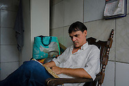 Amor de Deus Recovery Center, Del Castilho, Rio de Janeiro. A evangelism team member reads a bible. The majority of evangelism team is composed by crack dependents in advanced recovering stage.