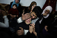 SYRIA - Homs province: One mother and her son cry the lost of her other two sons, killed by a mortar attack launched by Al Asad forces, in Homs province on February 20, 2012. ALESSIO ROMENZI