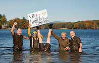 "The UPS Team hoists a big ""Thank You"" sign during Saturday afternoons 11th annual Turkey Plunge into Lake Opechee for the Salvation Army.  (l-r) Bill Peck, Mark Emery, Jim Gentile, Claire Cantin and Chris Gallagher.  (Karen Bobotas/for the Laconia Daily Sun)"