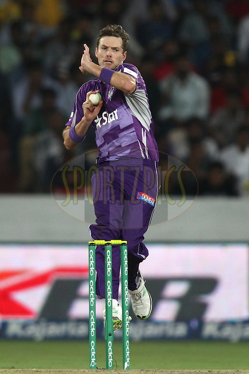 Ben Laughlin of the Hobart Hurricanes sends down a delivery during the first semi final match of the Oppo Champions League Twenty20 between the Kolkata Knight Riders and the Hobart Hurricanes held at the Rajiv Gandhi Cricket Stadium, Hyderabad, India on the 2nd October 2014<br /> <br /> Photo by:  Shaun Roy / Sportzpics/ CLT20<br /> <br /> <br /> Image use is subject to the terms and conditions as laid out by the BCCI/ CLT20.  The terms and conditions can be downloaded here:<br /> <br /> http://sportzpics.photoshelter.com/gallery/CLT20-Image-Terms-and-Conditions-2014/G0000IfNJn535VPU/C0000QhhKadWcjYs
