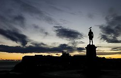 © Licensed to London News Pictures. <br /> 19/11/2016 <br /> Whitby, UK.  <br /> The sun begins to rise behind the James Cook monument on a cold Autumn sunrise in the North Yorkshire town of Whitby on the Northeast coast.  <br /> Photo credit: Ian Forsyth/LNP