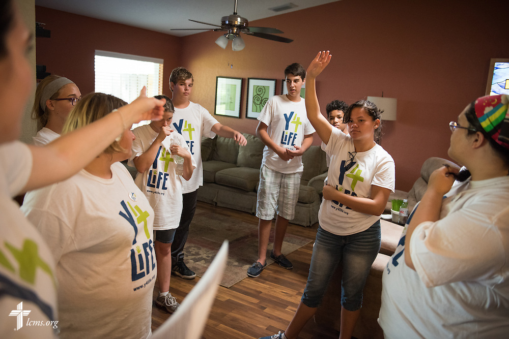 Laura Davis (far left), development counselor and director of Y4Life at Lutherans for Life, directs Y4Life student volunteers to different project sites during a servant event at Redeeming Life Maternity Home on Saturday, Sept. 12, 2015, in Sanford, Fla. LCMS Communications/Erik M. Lunsford