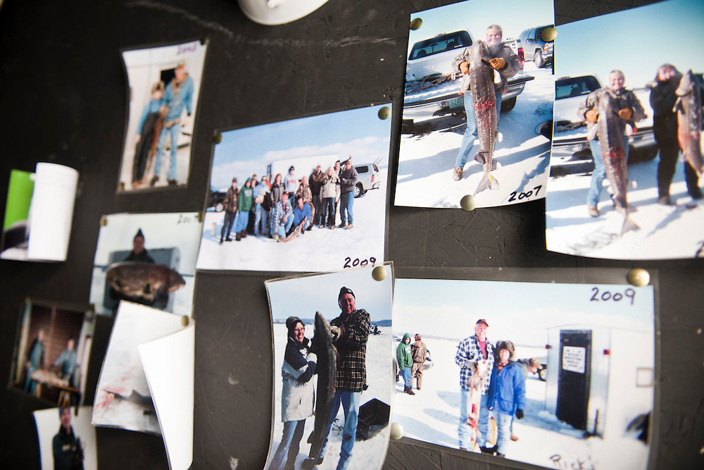 PIPE, WI -FEB. 16, 2015: Photographs from previous spear fishing years line the walls of Rick Hintz's shanty Monday, Feb. 16, 2015, reminding him of former successes on the lake. 13,000 licenses were sold for the 2015 sturgeon spearing season, and 233 fish were caught Monday between all of the registration stations, with 62 being registered in Stockbridge. The season started Feb. 14, 2015 and lasted until Feb. 21, 2015 on Lake Winnebago with a total of 1870 sturgeon speared. The average success rate for spearers is 10-12% and some people go years without spotting anything from their shanty. Lauren Justice for The New York Times