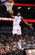 Oct 11, 2012; Orlando, FL, USA; Orlando Magic guard DeQuan Jones (20) dunks the ball during the fourth quarter against the Philadelphia 76ers at Amway Center. Philadelphia defeated Orlando 102-95.