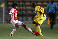 CAPE TOWN, SOUTH AFRICA - 11 FEBRUARY 2011, Sameehg Doutie of Ajax Cape Town attempts to tackle Vuyisile Wana of Santos during the Absa Premiership match between Santos and Ajax Cape Town held at Athlone Stadium in Cape Town, South Africa..Photo by: Shaun Roy/Sportzpics