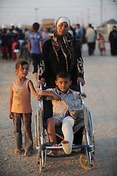 Syrian refugees at the Zaatari refugee camp in Jordan, September 3, 2012. Photo by Nick Cornish/i-Images.