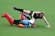 Katie Glynn goes over the top of England Goalie Maddie Hinch during a penalty shootout in extra time at the Black Sticks Women v England Semi Final match at the Glasgow National Hockey Stadium. Glasgow Commonwealth Games 2014. Friday 1 August 2014. Scotland. Photo: Andrew Cornaga/www.Photosport.co.nz
