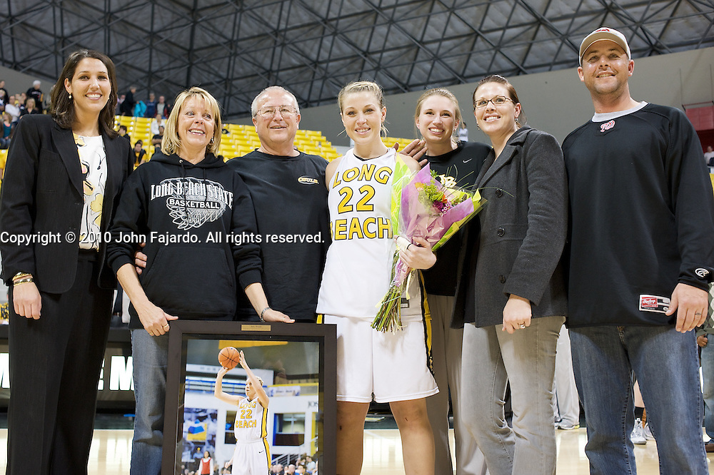 Ally Wade(22) with family and Head Coach Jody Wynn(L) during ceremonies honoring the team's Seniors at the Walter Pyramid, Long Beach CA, Saturday February 27, 2010.