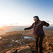 "Freyr Ingi Björnsson at the top of the iceclimb ""Nálaraugað"" WI4, with Reykjavík in the back,Búahamrar,mt. Esja."