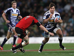 Schalk Brits of the Stormers attempts to get past Crusaders Captain Richie McCaw  during the Super Rugby Semi-Final match between DHL Stormers and the Crusaders held at DHL Newlands Stadium in Cape Town, South Africa on 2 July 2011...Photo by Shaun Roy / Sportzpics.net