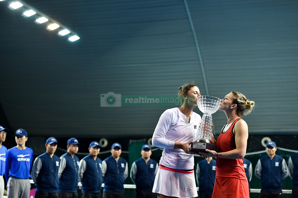 SHENZHEN, Jan. 6, 2018  Simona Halep (R) and Irina-Camelia Begu of Romania pose with the trophy after winning the doubles final against Katerina Siniakova and Barbora Krejcikova of the Czech Republic at the WTA Shenzhen Open tennis tournament in Shenzhen, China, Jan. 6, 2018. Simona Halep and Irina-Camelia Begu won 2-1. (Credit Image: © Mao Siqian/Xinhua via ZUMA Wire)