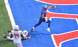 Sep 15, 2018; Lawrence, KS, USA; Kansas Jayhawks quarterback Miles Kendrick (8) scores a touchdown as Rutgers Scarlet Knights defensive lineman Kevin Wilkins (99) chases during the second half at Memorial Stadium. Kansas won 55-14. Mandatory Credit: Denny Medley-USA TODAY Sports