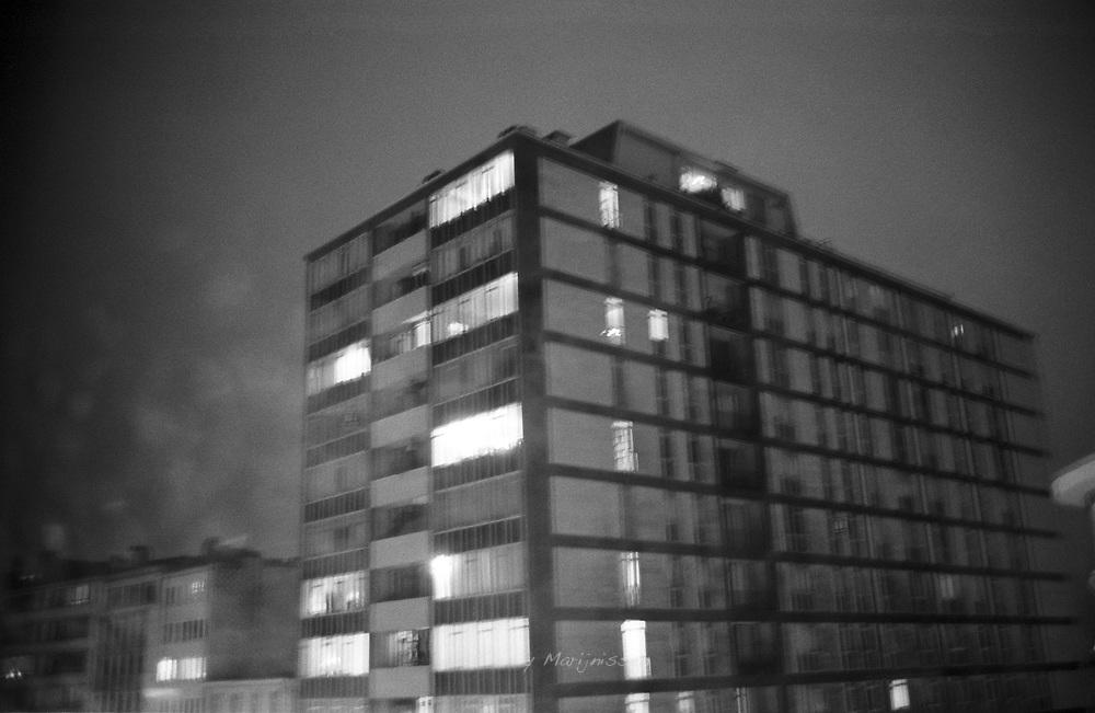 Photo of an apartment building through a rainy window. Antwerp, Belgium, 2008