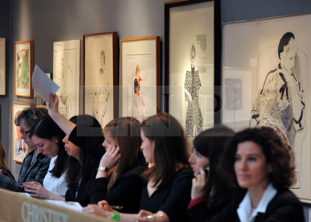 © Licensed to London News Pictures. 17/02/2012, London, UK. Telephone operators take bids during the sale. An auction of items by British artist David Hockney takes place at Christie's in London's South Kensington today, 17th February 2012. It features over 100 works by Hockney, including etchings, lithographs, drawings and photography. They are expected to sell for over £1m. The sale spans over 40 years of Hockney's career. Photo credit : Stephen Simpson/LNP