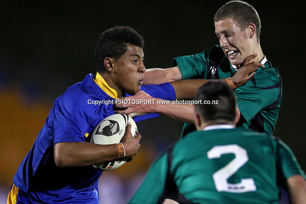 Northcote's Jerome Eki fends off Orewa's Louis Barker. NZRL Under 85kg Secondary Schools Rugby League match, Northcote College v Orewa College at Mt Smart Stadium, Auckland, New Zealand. Monday 17th September 2012. Photo: Anthony Au-Yeung / photosport.co.nz