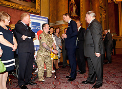 © Licensed to London News Pictures. 26/04/2012.  Prince William, the Duke of Cambridge chats to Royal Engineer Clive Smith (26) a double amputee at a Royal British Legion reception in the Goldsmiths Hall today in Central London.  Sapper Clive Smith was injured by an IED in Helmand in 2010.   He is currently going through a rehabilitation program at the Royal British Legions Battle Back facility... Photo credit: Alison Baskerville/LNP