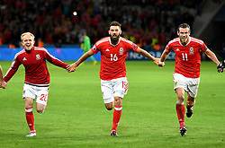 Jonathan Williams, Joe Ledley and Gareth Bale of Wales celebrates with the Wales fans after the game  - Mandatory by-line: Joe Meredith/JMP - 01/07/2016 - FOOTBALL - Stade Pierre Mauroy - Lille, France - Wales v Belgium - UEFA European Championship quarter final
