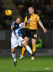 Stuart Sinclair of Bristol Rovers challenges for the header with Robbie Simpson of Cambridge United - Mandatory byline: Dougie Allward/JMP - 07966 386802 - 30/10/2015 - FOOTBALL - The Abbey Stadium - Cambridge, England - Cambridge United v Bristol Rovers - Sky Bet League Two