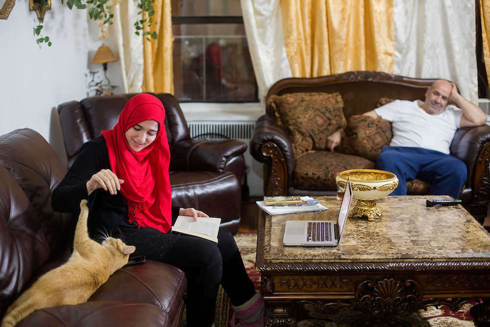 BRONX, NY - DECEMBER 10, 2015: Hebh Jamal, a 15-year-old Muslim, plays with her cat Prince at her family's apartment in the Bronx. CREDIT: Sam Hodgson for The New York Times.