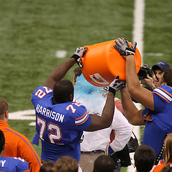 Jan 01, 2010; New Orleans, LA, USA;  Florida Gators head coach has gatorade dunked on him by player following a win over Cincinnati Bearcats in the 2010 Sugar Bowl at the Louisiana Superdome. Florida defeated Cincinnati 51-24.  Mandatory Credit: Derick E. Hingle-US PRESSWIRE.