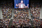 "Pictured on an overhead video display, Michael Pollan, author of the book ""In Defense of Food,"" is seen speaking to a crowd of nearly 7,000 people during a free lecture at the Kohl Center at the University of Wisconsin-Madison on Sept. 24, 2009. Pollan's book, which addresses the American food landscape, was selected for the university's Go Big Read common-reading program."
