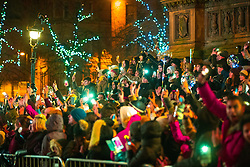 © Licensed to London News Pictures . 31/12/2017. Manchester, UK. Thousands watch as Manchester commemorate the start of 2018 , with a phone-lit tribute to the victims of Manchester Arena terror attack , in Albert Square . This year's celebration sees additional security, including concrete barriers around the square and bag searches and the event includes a poetry reading by Tony Walsh , in memory of those who were killed at a terrorist attack after at the Manchester Arena in May 2017. Photo credit: Joel Goodman/LNP