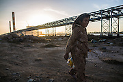 Attention Mona Boshnaq, for a story slugged Thermal by Mike Forsythe - An elderly woman walks past massive construction sites at Duyen Hai Complex in Tra Vinh Province. Vietnam, December 1st 2015.