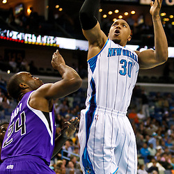December 15, 2010; New Orleans Hornets power forward David West (30) shoots over Sacramento Kings power forward Carl Landry (24) during the first half at the New Orleans Arena.  Mandatory Credit: Derick E. Hingle