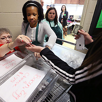 Adam Robison   BUY AT PHOTOS.DJOURNAL.COM<br /> Audry Roby, a teacher at Mooreville High School, hands change to a student as she helps her student Melody Texada, twelfth grade, sell biscuits in the hall to other students at Mooreville High School Tuesday morning.