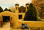 El Santuario de Chimayo, Chimayo, New Mexico, National Historic Landmark, southwest of Taos, 1814-1816, grandmother and granddaughter