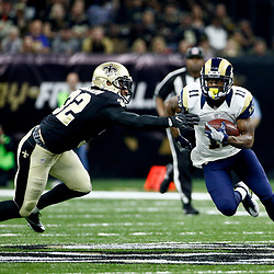 Nov 27, 2016; New Orleans, LA, USA;  Los Angeles Rams wide receiver Tavon Austin (11) runs past New Orleans Saints strong safety Kenny Vaccaro (32) after a catch during the first half of a game at the Mercedes-Benz Superdome. Mandatory Credit: Derick E. Hingle-USA TODAY Sports