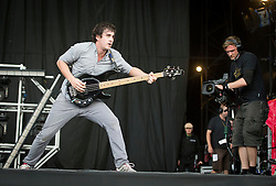 © London News Pictures. 25/08/2012. Reading, UK. Bass player Chris Batten performing with Enter Shikari on the main stage on day two of Reading Festival 2012 in Reading, Berkshire, UK on August 25, 2012. The three day event which attracts over 80,000 music fans headlines The Cure, Kasabian and The Foo Fighters Photo credit : Ben Cawthra/LNP
