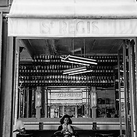 A woman takes a sip from her drink in the Café Saint-Régis in Paris, France 2015.