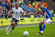 André Ayew of Swansea City takes on Joe Bennett of Cardiff City during the EFL Sky Bet Championship match between Cardiff City and Swansea City at the Cardiff City Stadium, Cardiff, Wales on 12 January 2020.
