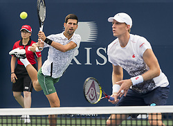 TORONTO, Aug. 7, 2018  Novak Djokovic (C) of Serbia and Kevin Anderson of South Africa compete during the frist round of men's doubles match against Denis ShapovalovFelix Auger-Aliassime of Canada at the 2018 Rogers Cup in Toronto, Canada, Aug. 6, 2018. Novak Djokovic and Kevin Anderson won 2-0. (Credit Image: © Xinhua via ZUMA Wire)
