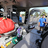 Todd Shelton, right, gives Noah Thornton, center, a look at the medical helicopter used by the North Mississippi Medical Center during Thursday's Career Expo at BancorpSouth Arena.