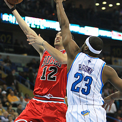 04 February 2009: Chicago Bulls guard Kirk Hinrich (12) shoots over New Orleans Hornets guard Devin Brown (23) during a 93-107 loss by the New Orleans Hornets to the Chicago Bulls at the New Orleans Arena in New Orleans, LA.