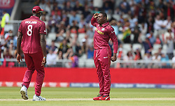 West Indies Sheldon Cottrell celebrates taking the wicket of New Zealand's Colin Munro with Jason Holder during the ICC Cricket World Cup group stage match at Old Trafford, Manchester.