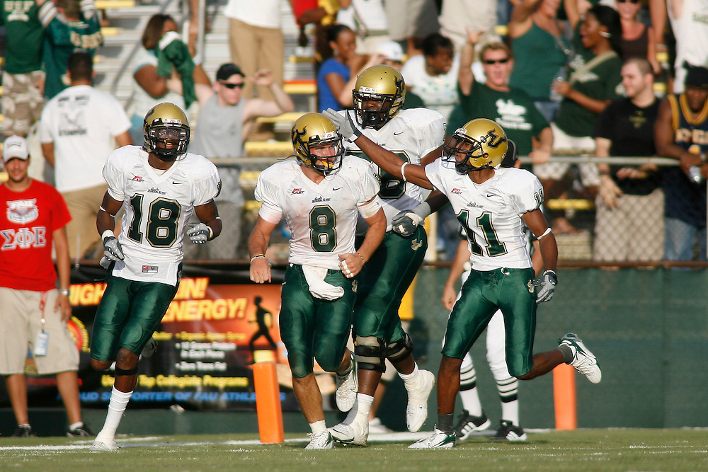 October 6, 2007 - Ft. Lauderdale, FL<br /> <br /> #8 Matt Grothe, #11 Marcus Edwards and #18 Amarri Jackson of the South Florida Bulls celebrate after a touchdown during the University of South Florida's 35-23 victory over Florida Atlantic University at Lockhart Stadium in Ft. Lauderdale, Florida.<br /> <br /> JC Ridley/CSM