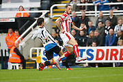 Newcastle United Defender Daryl Janmaat slides in on Stoke City Forward Marko Arnautovic  during the Barclays Premier League match between Newcastle United and Stoke City at St. James's Park, Newcastle, England on 31 October 2015. Photo by Craig McAllister.