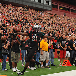 Oct 6, 2012: Rutgers Scarlet Knights wide receiver Mark Harrison (81) scores on a reception during second half NCAA college football action between the Rutgers Scarlet Knights and UConn Huskies at High Point Solutions Stadium in Piscataway, N.J.